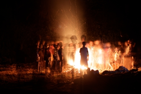 people around fire. photo by Damian Meoli